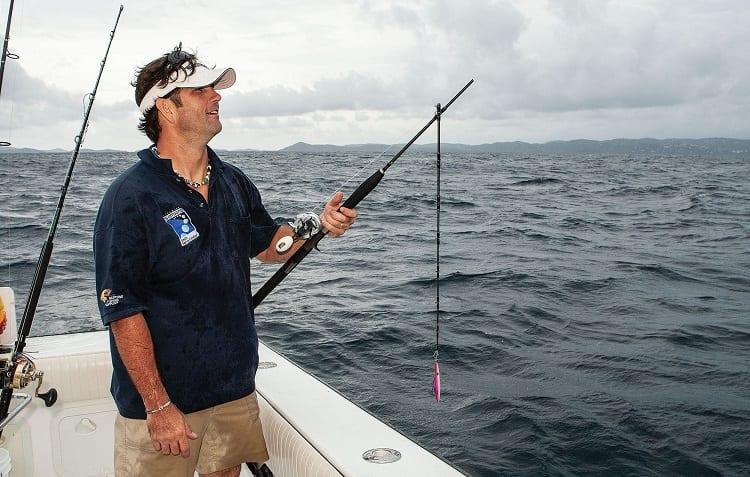 man on boat hold broken fishing rod