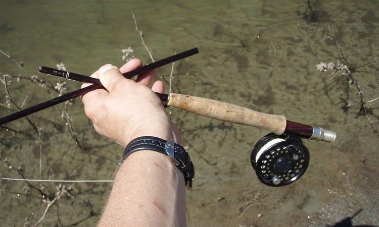 broken fly rod in mans hand