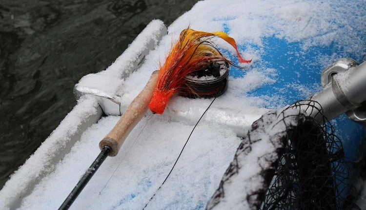 fly fishing rod in the snow
