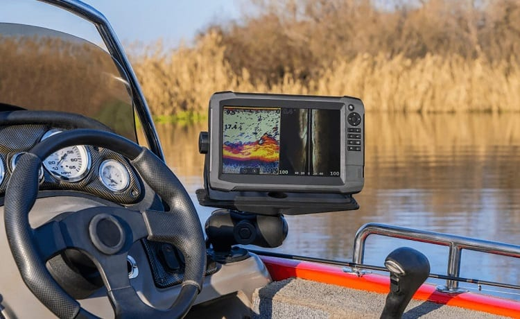 fishfinder mounted behind the wheel