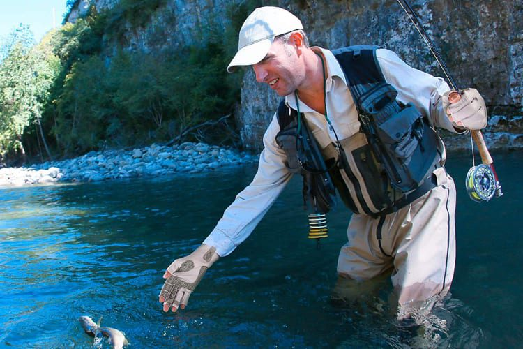 Fly fishing wearing gloves